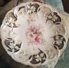 10 inch Unmarked Antique Floral Cake Plate With Cut Out Handles Excellent cond.
