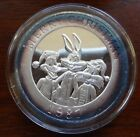 1987 Looney Tunes Merry Christmas Issue 1 ounce silver dollar