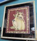 vintage framed mirror with victorian man and woman in center