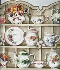 FLOWERED TEAPOTS CUPS AND SAUCERS ON SHELF SCULPTURED WALLPAPER BORDER