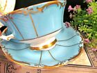PARAGON tea cup and saucer baby blue gold gilt textured teacup footed