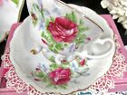 JAPAN tea cup and saucer 3 legged footed red roses pattern teacup