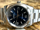 Rolex Oyster Perpetual 116000 36mm Blue Dial with Arabic Numerals Box Papers