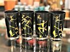 SET OF 4 TOM COLLINS  BLACK WITH 22K GOLD TUMBLERS OF TRIBAL AFRICAN DANCERS
