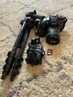 Nikon D7000 with 16-85mm DX lens and manfrotto tripod/charger/SD card