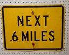 USED HIGH WAY SIGN NEXT 6 or 4 MILES BLACK ON YELLOW 18 X 24 AL