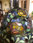 Tiffany style stained glass lamp adorned with jewel beads and bronze base