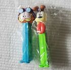 2 Pez Dispensers Garfield And Odie Cat Pilot Dog Candy In Plastic Vintage