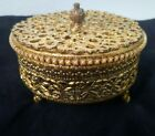 Vintage 24kt gold plated lidded jewelry trinket box vanity with glass insert