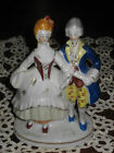 Vintage Occupied Japan Colonial Man and Woman figurine figure with gold accents