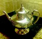 silver on cupper teapot