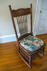 Vintage wood rocking chair with sculpted back