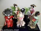 Dancing Geishas dolls ceramic and hand made attires, with flowers around 12