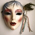 Clay Art Mask, 1989 with Feather and Beads