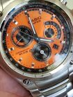 MUST SELL.BRAND-NEW EDIFICE  CASINO  CHRONOGHAPH WATCH ORANGE DIAL STAINLESS STL