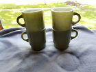 Set of four (4) Vintage Fire King green stackable coffee mugs.