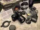 Olympus E-450 digital camera with 14-42mm lens, case, Box, Software and charger.