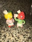 STRAWBERRY AND ORANGE HEAD ANTHROPOMORPHIC FRUIT SALT AND PEPPER SHAKERS