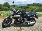 2006 Moto Guzzi Breva 1100  2006 Moto Guzzi Breva 1100 motorcycle. 3 Hard bags. Wind Shield. All Black.