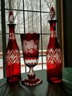 Bohemian Ruby Red Cut Etched Glass Decanters and Vase set with Stoppers