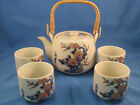 JAPANESE CERAMIC PORCELAIN TEAPOT WITH WICKER HANDLE AND TEACUP SET OF 4