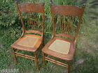 PAIR OF CARVED BACK NORTHWIND FACE POPLAR CHAIRS CANE SEATS