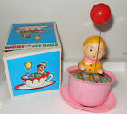 Vintage 1960's YONE plastic wind-up  Baby w/ Balloon in a PINK Coffee Cup NIB