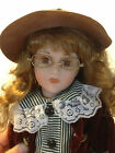 Knightsbridge Collection female porcelain doll in plaid dress with hat