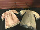 2 Primitive Handmade Doll Dresses with Hangers