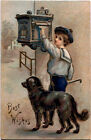 Antique BEST WISHES Postcard BOY AT MAILBOX BIG BLACK DOG GOLD Embossed Germany