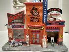 LEMAX 25383 GORDY'S CYCLE SHOP CHRISTMAS VILLAGE BUILDING RETIRED INCLUDES CORD