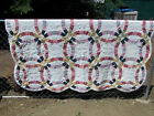 MACHINE MADE DOUBLE WEDDING RING QUILT WITH SCALLOPED EDGES 79 X 65 1 2 INCH