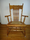America Antique 1900-1950 Oak Press Back North Winds Face Rocking Chair