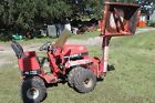 STEINER 430 MAX ARTICULATED TRACTOR WITH BOOM MOWER AND OTHER ATTCHMENTS