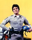 "ERIK ESTRADA IN THE TV SERIES ""CHiPs"" PONCH - 8X10 PUBLICITY PHOTO (OP-412)"