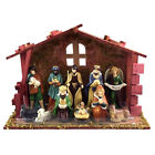 CHRISTMAS NATIVITY SET with 11 PORCELAIN FIGURES  MOSS DECORATED WOOD CRECHE
