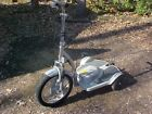 Transporter TRX unisex electric scooter:  Great condition, works fine, charger