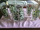 VINTAGE GLASS PITCHER AND 4 TALL GLASSES WITH FLOWERS LIBBY?