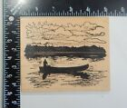 Northwoods Rubber Stamp Man In A Canoe Oar Sunrise Or Sunset Clouds Rubber Stamp