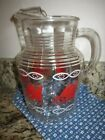 Vintage glass lemonade pitcher with sail boat motif. Anchor Hawking.