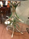 MCM BEVELED GLASS OVAL COFFEE TABLE WITH PAINTED WROUGHT IRON FLOWER BASE
