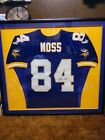 FRAMED AUTHENTIC MINNESOTA VIKINGS RANDY MOSS AUTOGRAPHED PUMA JERSEY UDA