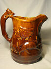 Yellowware Rockingham Glaze Eagle on Hound Handle Pitcher 19th c 10 1/8  in. h