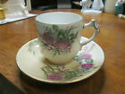 ANTIQUE PORCELAIN DEMITASSE TEACUP & SAUCER WHITE PURPLE FLOWERS AND GREEN