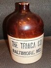 OLD ADVERTISING CROCK WHISKEY JUG  THE TRIACA CO. BALTIMORE MD.
