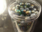 Full jar of Champion Carnival Glass marbles found inside old factory
