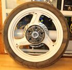 1992 SUZUKI GS500E   REAR WHEEL WITH WORN TIRE AS SHOWN NEED REPAINT