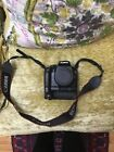 Canon EOS Rebel T3 1100D 122MP Digital SLR Camera Body with grip