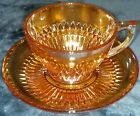 IRIDESCENT MARIGOLD CARNIVAL CUT GLASS JEANNETTE CUP AND SAUCER