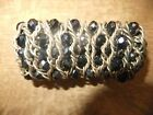 LARGE FRECH JET AND TWISTED GILT METAL ELASTIC BRACELET VERY DRAMATIC